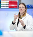 Female researcher carrying out experiments in lab Royalty Free Stock Photos