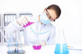 Female researcher pouring chemicals in a laboratory Stock Images
