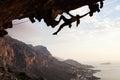 Female rock climber at sunset