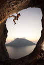 Female rock climber at sunset Royalty Free Stock Photo