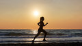 Female runner on beach Royalty Free Stock Photo