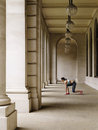 Female runner crouching in portico full length side view of a starting position Royalty Free Stock Images