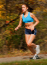Female runner in motion Stock Image