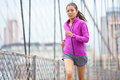 Female runner running and jogging in new york city woman sport athlete training outdoor for marathon living healthy lifestyle Stock Image