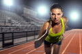 Female runner sprinter exercising and training intense track and field athlete determination for greatness in sports with Stock Images