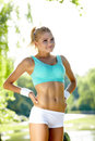 Female runner stretching before her workout an attractive Royalty Free Stock Photo