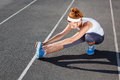 Female runner stretching before workout outdoor shot Royalty Free Stock Images
