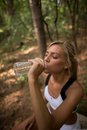 Female runners hydration blonde runner drinking water Royalty Free Stock Images