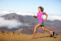 Female running athlete woman trail runner sprinting for success goals and healthy lifestyle in amazing nature landscape cross Stock Photos