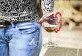 Female`s hand with red long nails holding a wine glass Royalty Free Stock Photo