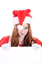 Female santa with a banner young woman in mrs claus hat holding blank sign isolated on white extra white space your message can be Royalty Free Stock Photography