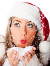 Female Santa blowing snow Stock Image