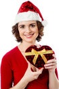 Female santa with christmas gift beautiful pretty woman posing xmas Royalty Free Stock Images