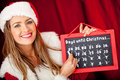 Female Santa counting days for Christmas Royalty Free Stock Photos