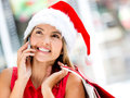 Female Santa on the phone Stock Photo