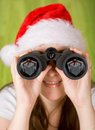 Female santa searching for gifts Royalty Free Stock Photo
