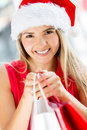 Female Santa on a shopping spree Stock Photography