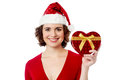 Female santa showing xmas gift over white cheerful posing with christmas Stock Photography