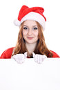 Female santa young woman in mrs claus hat holding a blank sign isolated on white Stock Image