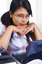 Female scholar looking at her laptop Stock Photography