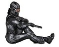 Female science fiction soldier sitting futuristic in protective armoured space suit at rest holding pistols d digitally rendered Stock Photography