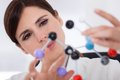 Female scientist concentrating molecular structure laboratory Royalty Free Stock Images