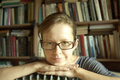 Female scientist in front of books close up portrait Stock Photos
