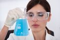Female Scientist Holding Chemical
