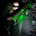 Female scientist  in a quantum optics lab Royalty Free Stock Photo