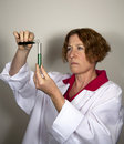 Female Scientist with Test Tubes Stock Images