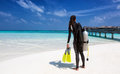 Female scuba diver with diving equipment on the beach Royalty Free Stock Photo