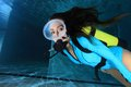 Female scuba diver with lycra suit underwater in the pool Royalty Free Stock Photos
