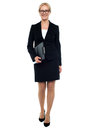 Female secretary holding clipboard Royalty Free Stock Photography