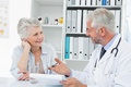 Female senior patient visiting a doctor at the medical office Stock Images