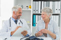 Female senior patient visiting doctor a at the medical office Stock Photography
