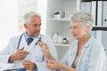 Female senior patient visiting doctor a at the medical office Royalty Free Stock Image