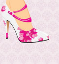 Female shoes on the decorative background Stock Images