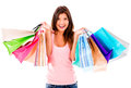 Female shopaholic holding a bunch of shopping bags isolated over white Stock Images
