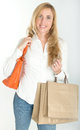 Female shopper with credit card blond woman shopping bags holding a Royalty Free Stock Image