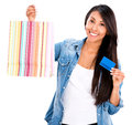 Female shopper with a credit card happy isolated over white background Royalty Free Stock Photo