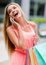 Female shopper on the phone happy talking and smiling Stock Image