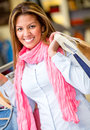 Female shopper shopping center holding bags Stock Photo