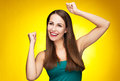 Female showing peace sign casual young woman over yellow background Stock Photography