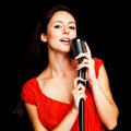 Female singer performing live in a concert Royalty Free Stock Photography