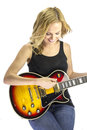 Female singer songwriter musician with electric guitar a young an is isolated on white the is red black and yellow Royalty Free Stock Photo