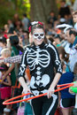 Female Skeleton Does Hula Hoop At Halloween Parade Stock Photos