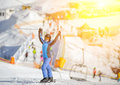 Female skier with arms up on a ski slope Royalty Free Stock Photo