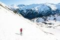 Female skier ascending a mountain slope ski touring in malta valley austria Royalty Free Stock Photo