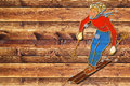 Female skier dark board vintage cartoon interpreted as a metal shield on wooden Stock Images