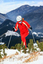 Female skier moving up slope
